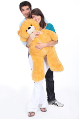portrait of teenagers with big teddy bear