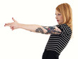 Red Head Pretending to Aim and Shoot with Arm Covered in Tattoos