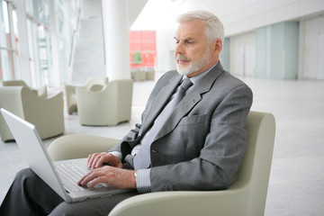 Senior businessman waiting in airport