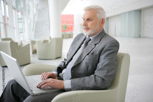 Senior businessman waiting in airport