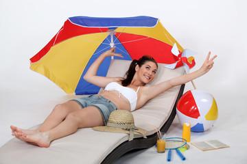 woman at beach enjoying paid leave