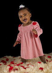 Black baby girl in pink dress