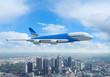 White passenger plane flying above a city