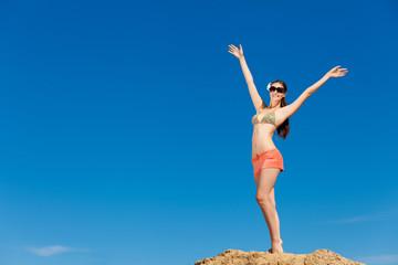 Portrait of young woman in bikini at beach