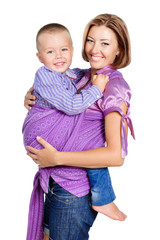 happy mother carrying baby boy 3-4 years old in sling isolated o