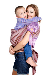happy mother hugging her baby boy 3-4 years old in sling isolate