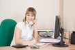 businesswoman  in office speaking by phone