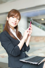 Beautiful business woman using a cellular