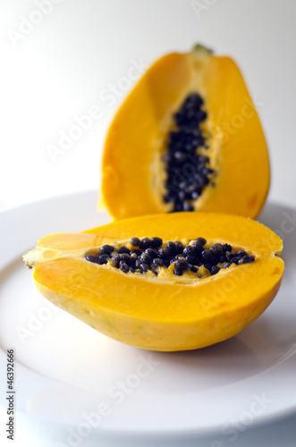 Pawpaw or Papaya isolated on a white plate
