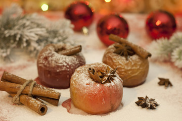 Christmas food baked apples closeup and cinnamon with anise