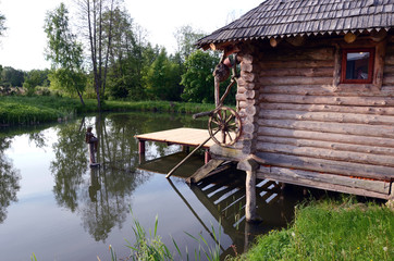 wooden bathhouse and summer  pond