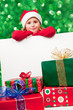 Christmas - kid Santa Claus with gifts and white board