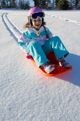 Winter, snow, girl sledding at winter time