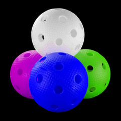 Four floorball balls isolated on a black background