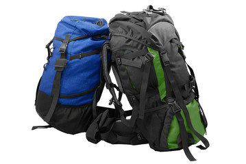Two used tourist backpacks isolated on white