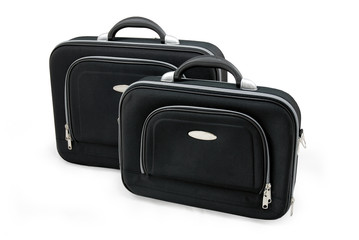 Two black suitcases - vacation baggage - isolated