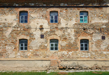 Old orange brick wall with six windows