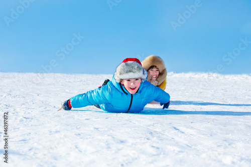 Sister and brother sliding down