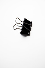 Single binder clip over white background