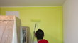 Man Painting a Room