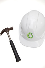 Hammer and hard with recycling symbol against white background