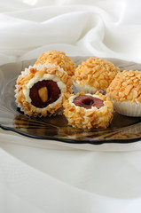 Cheese balls with cherries in peanuts