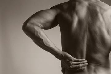 Muscular Man with Backache