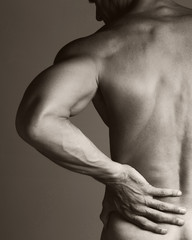 Muscular Man with Backache