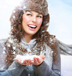 Christmas Girl. Winter woman Blowing Snow