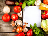 Fototapety Open Notebook and Fresh Vegetables Background. Diet