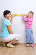 Woman and girl with measurement level