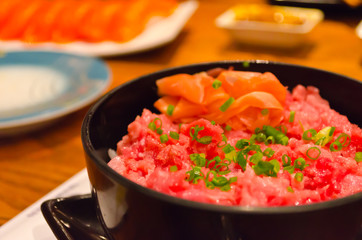 Toro Donburi in the black bowl.