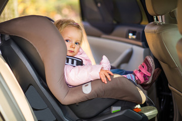 Infant baby girl in car seat