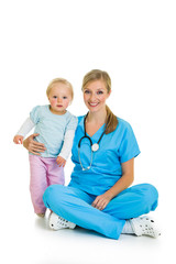 Doctor with toddler child isolated on white