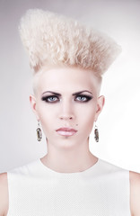 close up portrait of futuristic blond woman with creative hairst