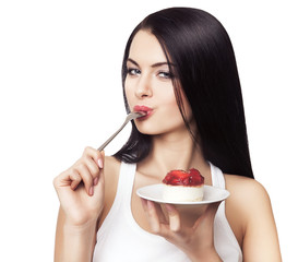 woman licking spoon with cake