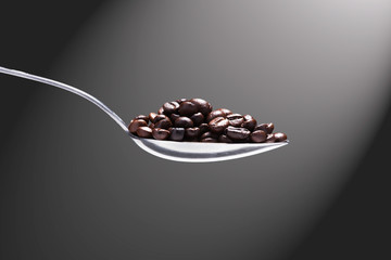 Coffe beans on a spoon