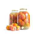 Preserved red tomatoes in a glass jar