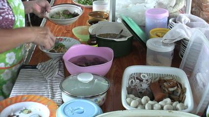 Asian Woman Prepares Noodle Soup