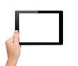 Leinwandbild Motiv woman hand hold a mini tablet with isolated screen