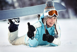 Female snowboarder showing thumbs up