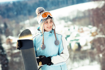 Young beautiful woman with snowboard