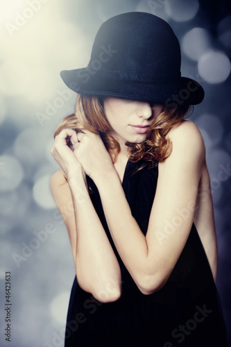 Portrait of beautiful redhead girl in hat.