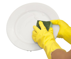 hands in yellow gloves wash  white plate