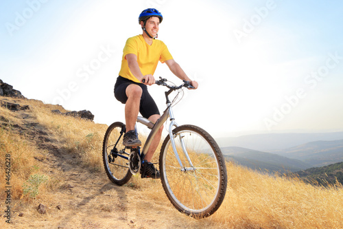 Biker riding a mountain bike on a sunset
