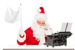 Disappointed Santa Claus with typing machine waving a flag gestu