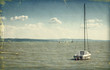 Vintage style photo. Sailing boat on lake