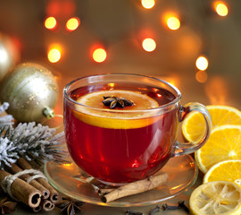 Christmas drink punch and spices on colorful background