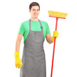 Male cleaner holding a brush