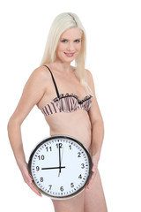 Woman in her underwear with a clock showing 9:00